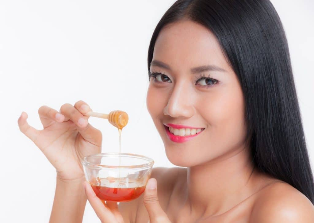 Apply Milk With Honey And Strawberries For Straighten Hair Naturally